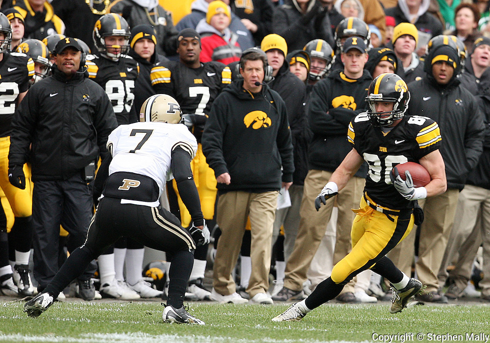 15 NOVEMBER 2008: Iowa wide receiver Andy Brodell (80) tries to get around Purdue safety Brandon King (7) in the first half of an NCAA college football game against Purdue, at Kinnick Stadium in Iowa City, Iowa on Saturday Nov. 15, 2008. Iowa beat Purdue 22-17.