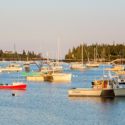 Lobster boats and sailboats in Tenants Harbor, Maine.