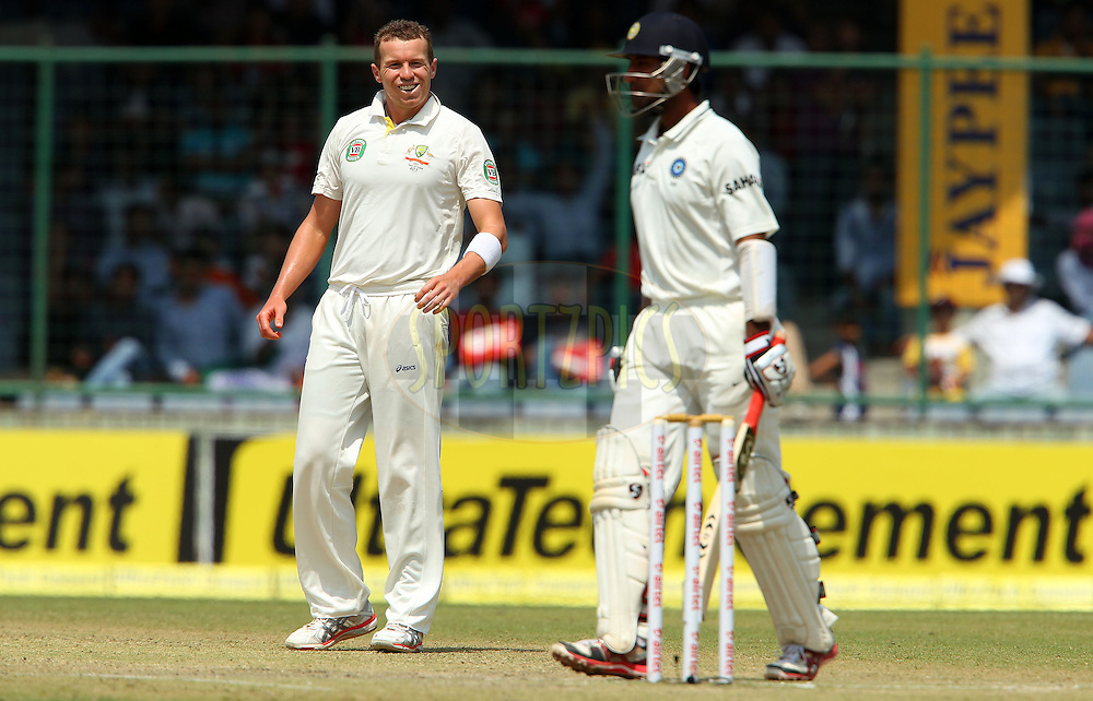 Peter Siddle of Australia reacts after bowling during day 2 of the 4th Test Match between India and Australia held at the Feroz Shah Kotla stadium in Delhi on the 23rd March 2013..Photo by Ron Gaunt/BCCI/SPORTZPICS ..Use of this image is subject to the terms and conditions as outlined by the BCCI. These terms can be found by following this link:..http://www.sportzpics.co.za/image/I0000SoRagM2cIEc