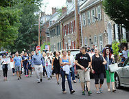 A group marches on a street during an anti racism vigil and in support of Charlottesville Monday, August 14, 2017 in Newtown, Pennsylvania. After some speeches, the group walked to Newtown Friends Meetinghouse. (Photo by William Thomas Cain)