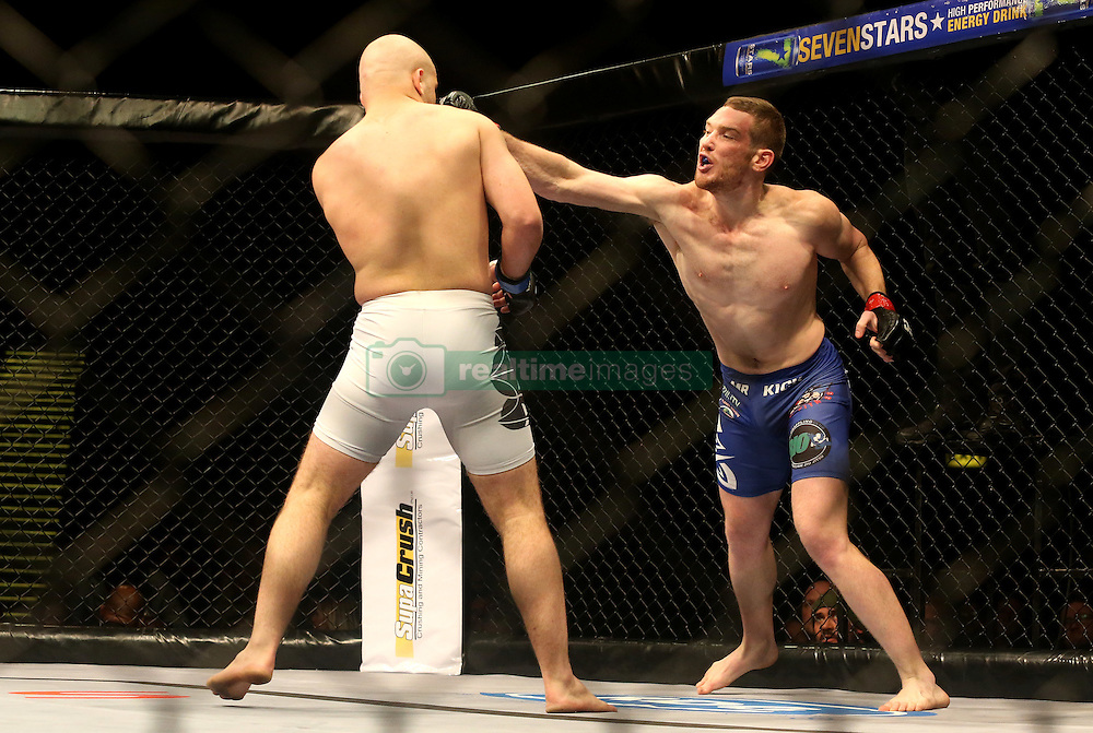 Stefan Pretorius (Red) punches Armand Scheepers (Blue) during the fifth bout of the Extreme Fighting Championships, EFC 52 held at the Grand West Casino in Cape Town, South Africa on the 5th August 2016<br /> <br /> Photo by:   Shaun Roy / Real Time Images