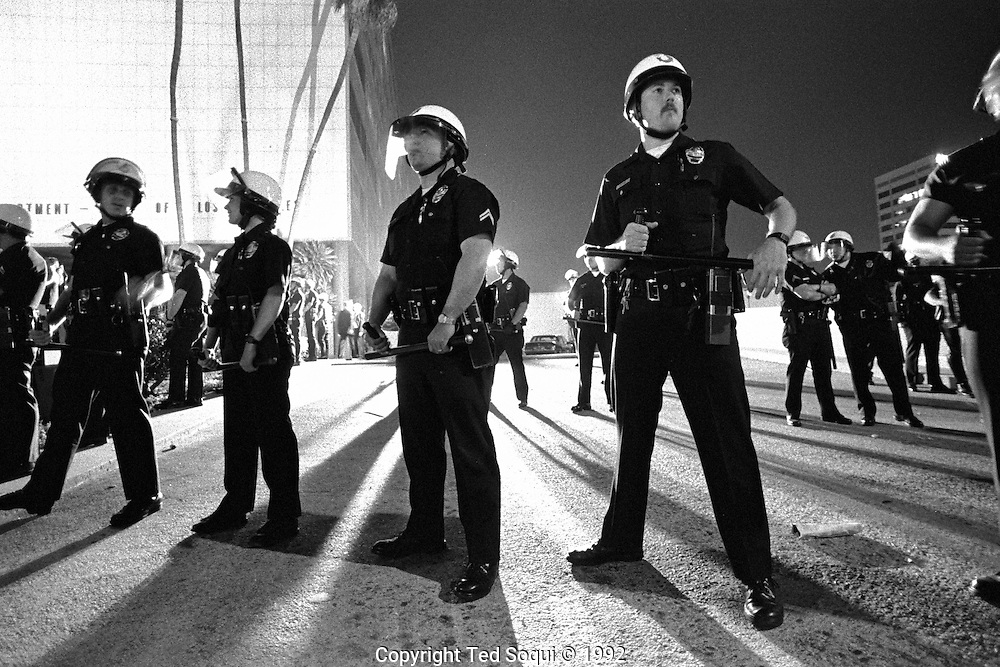 LAPD officers hold a line in front of LAPD headquarters, in downtown Los Angeles..Los Angeles has undergone several days of rioting due to the acquittal of the LAPD officers who beat Rodney King..Hundreds of businesses were burned to the ground and over 55 people have been killed.