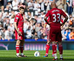 NEWCASTLE-UPON-TYNE, ENGLAND - Sunday, April 1, 2012: Liverpool's captain Steven Gerrard MBE and Jonjo Shelvey look dejected as Newcastle United score the first goal during the Premiership match at St James' Park. (Pic by Vegard Grott/Propaganda)