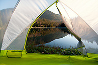 A tent is set up by Lightning Lake in Manning Park, BC, Canada