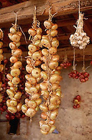 August 1997, Tuscany, Italy --- Hanging Garlic and Onions Drying --- Image by © Owen Franken/CORBIS