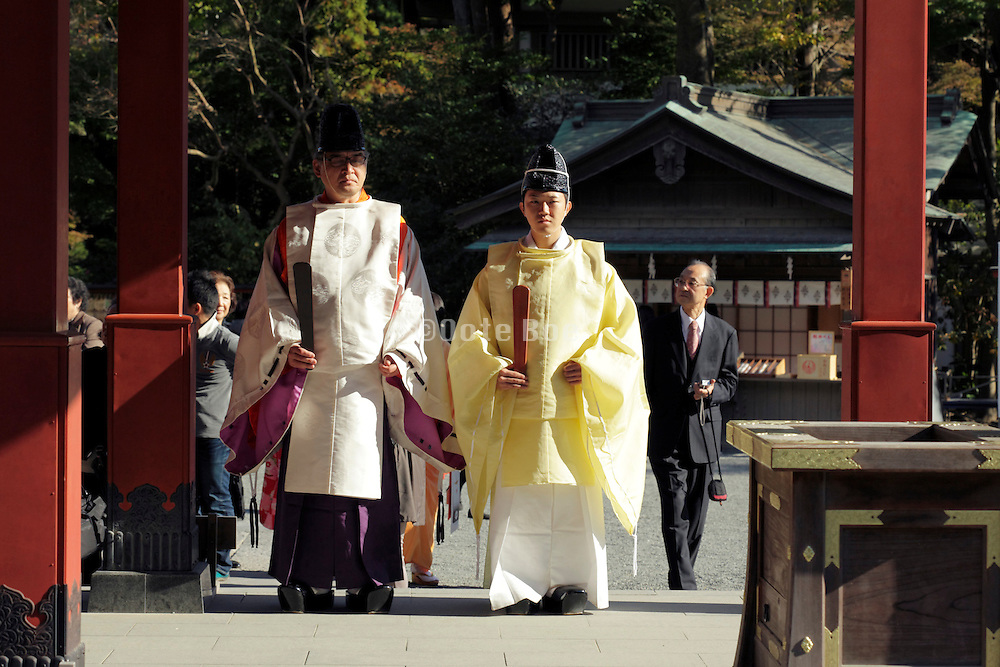 priests waiting for bride and groom at the end of a traditional Shinto wedding ceremony Kamakura Japan
