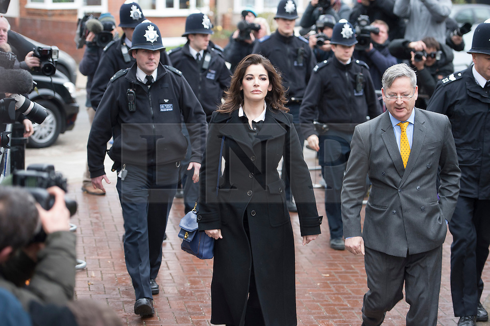 ©  London News Pictures. File picture dated 04/12/2013. London, UK. Television cook, NIGELLA LAWSON arriving at Isleworth Crown Court in London where she is due to give evidence in the trial of two former personal assistants who worked for her and Charles Saatchi. Italian Sisters Elisabetta and Francesca Grillo are accused of misappropriating funds while working for Saatchi and Lawson. Photo credit : Ben Cawthra/LNP