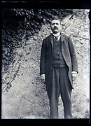man in suit posing with a garden wall as background France circa 1930s
