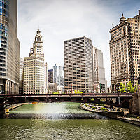 Photo of Chicago Downtown at Wabash Avenue Bridge with the Chicago River, Trump Tower, the Wrigley Building, and the Equitable building. Photo is high resolution and was takein in May 2010.