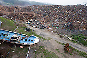 Photo shows a waste collection site where debris from the March 11 tsunami is collected and sorted in Yamada Town, Iwate Prefecture, Japan on  10 June 2011. Authorities are unable to dispose of much of the debris created by the March disasters due to fears of radiation contamination, leading to giant mounds of waste that are becoming increasingly more toxic. The disaster is estimated to have left behind some 25 million tons of waste. Photographer: Robert Gilhooly