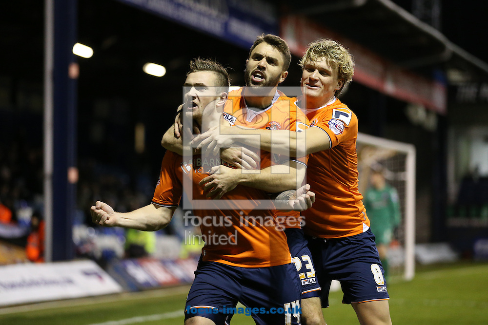 Jack Marriott of Luton Town (front) celebrates scoring the opening goal against Carlisle United with Josh McQuoid of Luton Town and Cameron McGeehan of Luton Town during the Sky Bet League 2 match at Kenilworth Road, Luton<br /> Picture by David Horn/Focus Images Ltd +44 7545 970036<br /> 24/11/2015