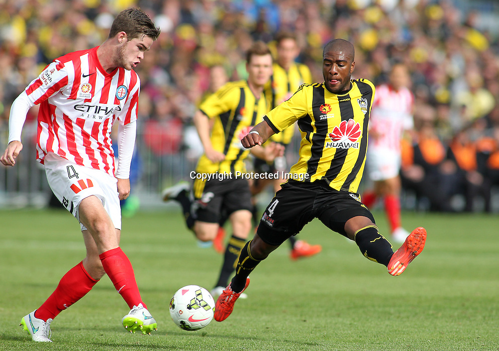 Phoenix' Roly Bonevacia attempts to stop a pass from Melbournes' Connor Chapman during the A-League football match between the Wellington Phoenix & Melbourne City, at the Hutt Recreational Ground, Wellington, 14 February 2015. Photo.: Grant Down / www.photosport.co.nz