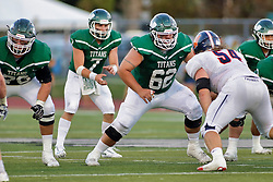 {BLOOMINGTON, IL: Brandon Bauer, Kyle Cook during a college football game between the IWU Titans  and the Wheaton Thunder on September 15 2018 at Wilder Field in Tucci Stadium in Bloomington, IL. (Photo by Alan Look)