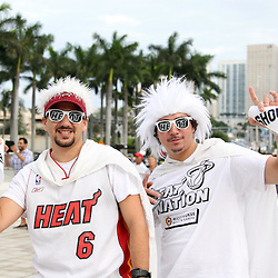 Jun 21, 2012; Miami, FL, USA; Miami Heat fans Louis Arzani (left) and Christian Carranza (right) outside American Airlines Arena before game five in the 2012 NBA Finals against the Oklahoma City Thunder. Mandatory Credit: Derick E. Hingle-US PRESSWIRE