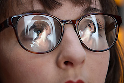 "© Licensed to London News Pictures. 06/10/2017. London, UK.   ""Lucia, back 3"", 2017, a new work by Julian Opie is reflected in a staff member's glasses at the unveiling of the artwork at the National Portrait Gallery. Photo credit : Stephen Chung/LNP"