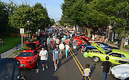 Pedestrians view the over 300 vehicles on display during the 6th Annual Doylestown at Dusk Car Show Saturday July 18, 2015 in Doylestown, Pennsylvania. (Photo by William Thomas Cain)