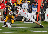 October 23 2010: Iowa Hawkeyes wide receiver Derrell Johnson-Koulianos (15) is hit by Wisconsin Badgers cornerback Niles Brinkley (29) and Wisconsin Badgers linebacker Blake Sorensen (9) during the first half of the NCAA football game between the Wisconsin Badgers and the Iowa Hawkeyes at Kinnick Stadium in Iowa City, Iowa on Saturday October 23, 2010. Wisconsin defeated Iowa 31-30.