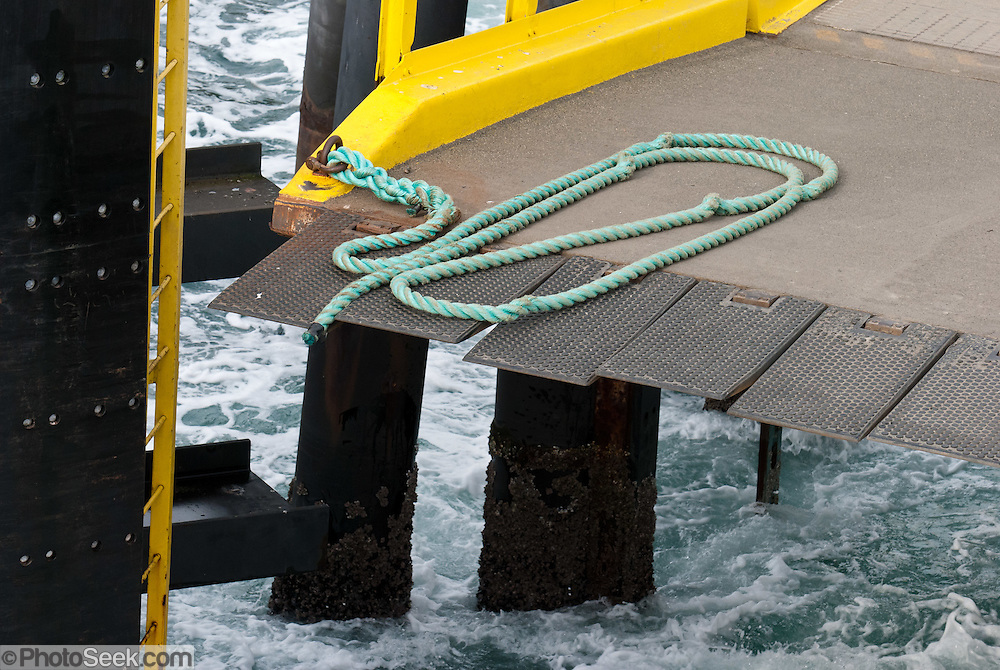 A rope assists ferry docking at Orcas Island Terminal for Washington State Ferries, Harney Channel, San Juan Islands, USA