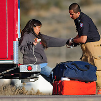 020113  Adron Gardner<br /> <br /> A Gallup Fire and Rescue emergency responder attends to a woman injured at the scene of a vehicle versus pedestrian accident at mile marker 2 on U.S. Highway 491 in Gallup Friday.