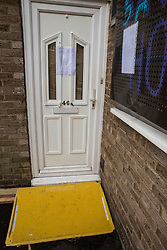 Eviction notices are fixed around the door to the home of Mostafa Aliverdipour, the last surviving resident of the Sweets Way housing estate, on 23rd September 2015 in London, United Kingdom. A group of housing activists calling for better social housing provision in London had occupied some of the properties on the 142-home estate in Whetstone, in some cases refurbishing properties intentionally destroyed by the legal owners following eviction of the original residents, in order to try to prevent or delay the eviction of Mr Aliverdipour and the planned demolition and redevelopment of the entire estate by Barnet Council and Annington Property Ltd.