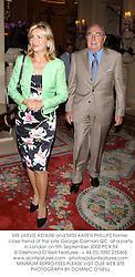 MR JARVIS ASTAIRE and MISS KAREN PHILLIPS former close friend of the late George Carman QC. at a party in London on 5th September 2002.PCX 59