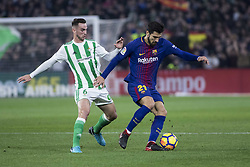 January 21, 2018 - Seville, Spain - ANDRE GOMES of Barcelona (R ) vies for the ball with FABIAN of Betis (L ) during the La Liga soccer match between Real Betis and FC Barcelona at Benito Villamarin Stadium (Credit Image: © Daniel Gonzalez Acuna via ZUMA Wire)