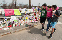 Mason McGonagle, Ciara LaGarde and Nick Murray walk joined together at the memorial for Lily Johnson on the Messer Street bridge following Friday's tragic accident.  (Karen Bobotas/for the Laconia Daily Sun)