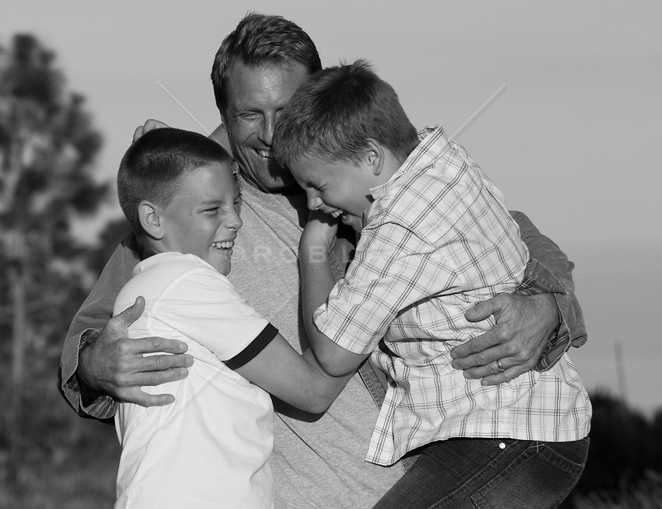 father and sons outdoors enjoying time together