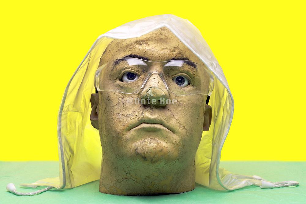 head with transparent plastic rain cover