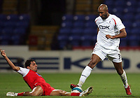 Photo: Paul Thomas.<br /> Bolton Wanderers v Braga. UEFA Cup. 25/10/2007.<br /> <br /> Nicolas Anelka (R) of Bolton is tackled by Wender (L). *** Local Caption *** *** UK ONLY ***