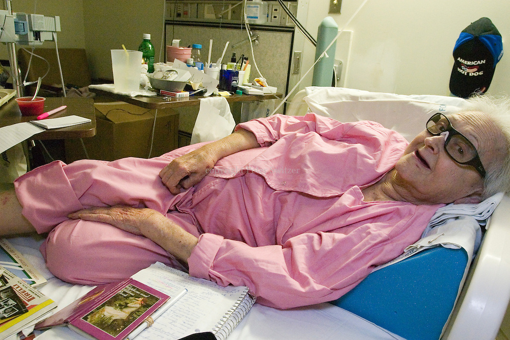 Verna D. Combs, Korean War Veteran, tries to stay comfortable in between her dinner, and her writing, at The Veterans Administration Hospital in Westwood, Ca. Nov. 13, 2005.