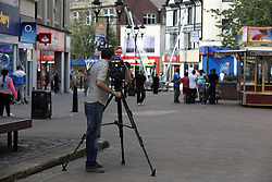 UK ENGLAND ROTHERHAM 28AUG14 - A cameraman takes footage in the town centre of Rotherham, epicentre of the largest child sex abuse scandal in Britain.<br /> <br /> An August 2014 report found that around 1,400 children had been sexually exploited in the town between 1997 and 2013, mainly by British-Pakistani men.<br /> <br /> jre/Photo by Jiri Rezac<br /> <br /> &Acirc;&copy; Jiri Rezac 2014