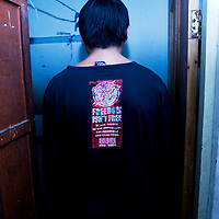 "LHASA, JUNE-16, 2009 :  Gujia ( pseudonym), poses with a t-shirt "" freedom isn't free"" in a bar. The young man says he participated in the anti-Chinese protests in 2008 and spent  4 months  and 27 days in jail . His "" hobby "" is  to drink and  provoke soldiers at night time in Lhasa's streets. He doesn't mind the increased  security measures  and his nightly fights often result in additional jail visits. Gujia claims  that "" every soldier and police man "" know him in Lhasa."
