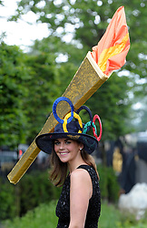 © Licensed to London News Pictures. 21/06/2012. Ascot, UK A woman wears a hat of the Olympic Torch. Ladies Day at Royal Ascot 21st June 2012. Royal Ascot has established itself as a national institution and the centrepiece of the British social calendar as well as being a stage for the best racehorses in the world.. Photo credit : Stephen Simpson/LNP