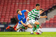 Armstrong Oko-Flex (#11) of Celtic FC holds off Ben Williamson (#4) of Rangers FC during the Scottish FA Youth Cup Final match between Celtic and Rangers at Hampden Park, Glasgow, United Kingdom on 25 April 2019.