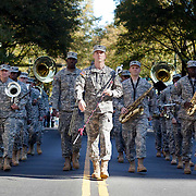 An Army marching band makes their way down Tryon Street in Uptown Charlotte during the 2011 Veterans Day Parade.