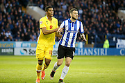 MK Dons defender Jordan Spence (12)  holds onto Sheffield Wednesday defender, on loan from Watford, Daniel Pudil (36)  during the Sky Bet Championship match between Sheffield Wednesday and Milton Keynes Dons at Hillsborough, Sheffield, England on 19 April 2016. Photo by Simon Davies.