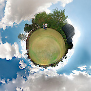 Polar panorama of a mature couple in a park
