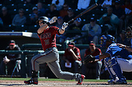 SURPRISE, AZ - MARCH 06:  Chris Owings #16 of the Arizona Diamondbacks singles during the sixth inning of the spring training game against the Kansas City Royals at Surprise Stadium on March 6, 2017 in Surprise, Arizona.  (Photo by Jennifer Stewart/Getty Images)