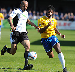 Bristol Rovers' Ellis Harrison challenges Dover Athletic's Richard Orlu - Photo mandatory by-line: Neil Brookman/JMP - Mobile: 07966 386802 - 18/04/2015 - SPORT - Football - Dover - Crabble Athletic Ground - Dover Athletic v Bristol Rovers - Vanarama Football Conference