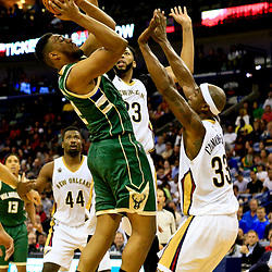 Nov 1, 2016; New Orleans, LA, USA; Milwaukee Bucks forward Jabari Parker (12) shoots over New Orleans Pelicans forward Anthony Davis (23) and forward Dante Cunningham (33) during the second quarter of a game at the Smoothie King Center. Mandatory Credit: Derick E. Hingle-USA TODAY Sports