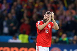 LILLE, FRANCE - Friday, July 1, 2016: Wales' Joe Ledley applauds the supporters as he is substituted during the UEFA Euro 2016 Championship Quarter-Final match against Belgium at the Stade Pierre Mauroy. (Pic by Paul Greenwood/Propaganda)
