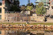 A runner at the Art Crossing and River Place development on the Reedy River in downtown Greenville, South Carolina.