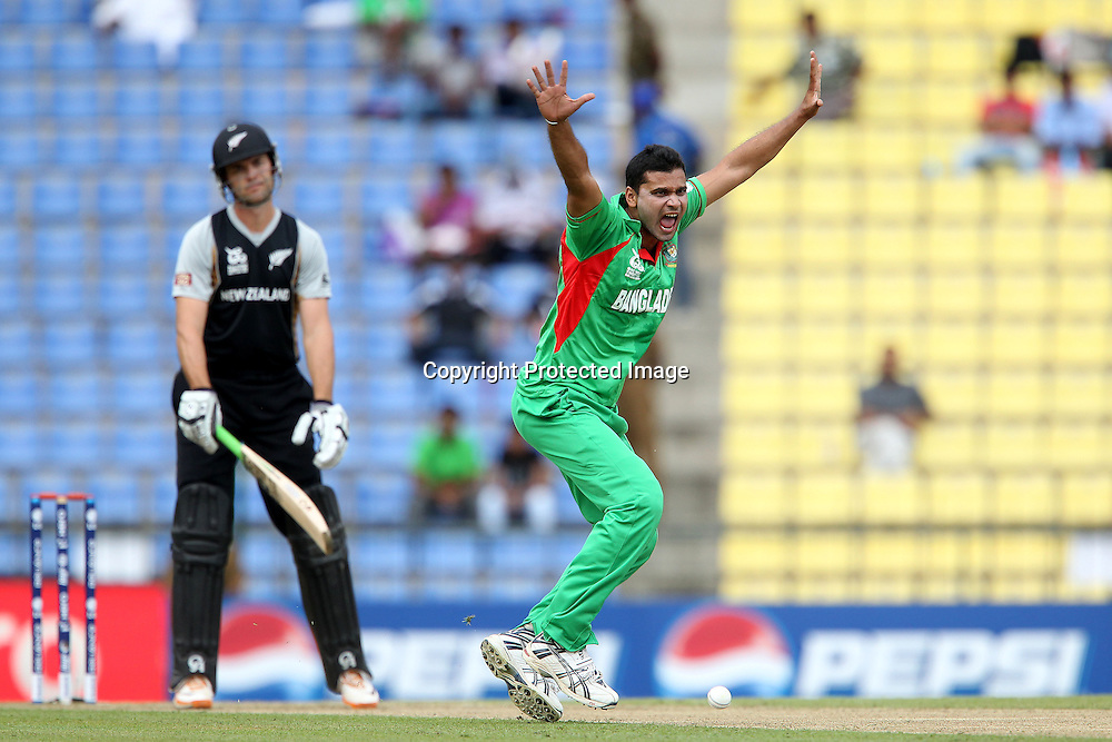 Mashrafe Mortaza appeals in vain for the wicket of James Franklin during the ICC World Twenty20 Pool match between New Zealand and Bangladesh held at the  Pallekele Stadium in Kandy, Sri Lanka on the 21st September 2012<br /> <br /> Photo byRon Gaunt/SPORTZPICS/PHOTOSPORT