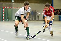 ARNHEM - Sjoerd Gerretsen met Rogier Rombouts van Hurley (r) , De mannen van Rotterdam tijdens de eerste dag van de zaalhockey competitie in de hoofdklasse, seizoen 2013/2014. COPYRIGHT KOEN SUYK