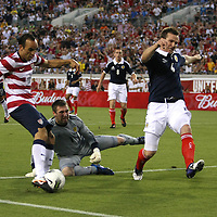 United States Forward Landon Donovan (10) scores a goal past Scotland goalkeeper Allan McGregor during an international friendly soccer match between Scotland and the United States at EverBank Field on Saturday, May 26, 2012 in Jacksonville, Florida.  The United States won the match 5-1 in front of 44,000 fans. (AP Photo/Alex Menendez)