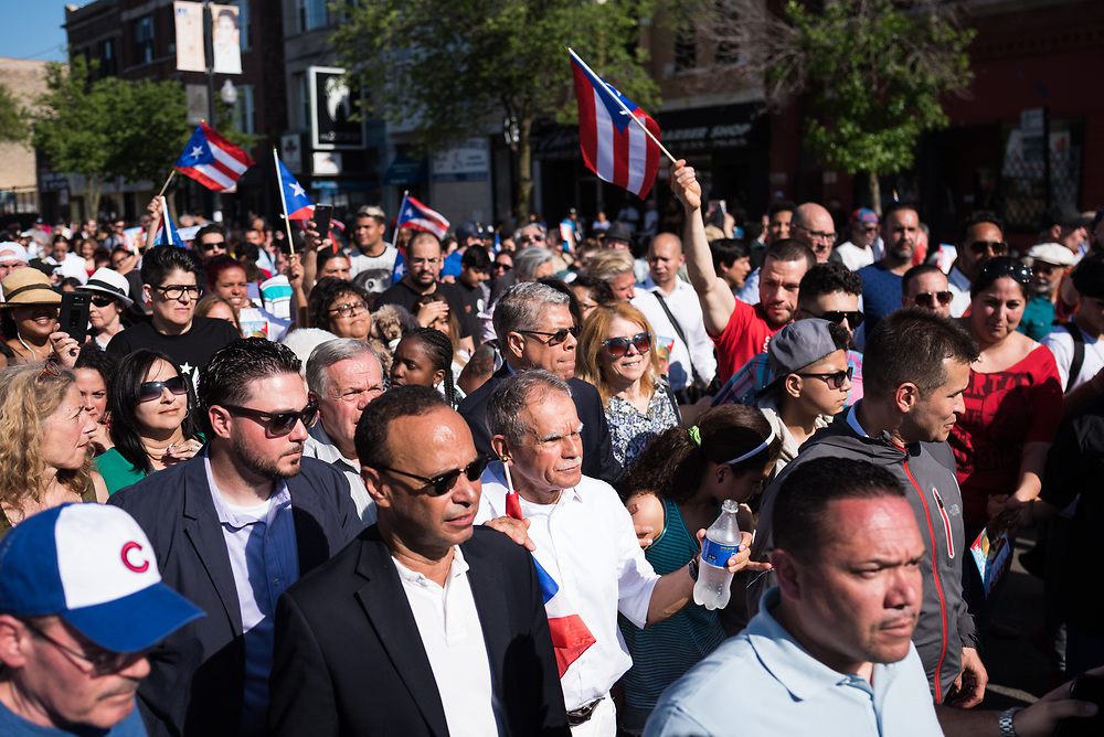 Puerto Rican nationalist Oscar López Rivera, with Congressman Luis Gutierrez by his side, walks down West Division Street towards Humboldt Park during his welcome home celebration on May 18, 2017 after he faced 35 years of incarceration.