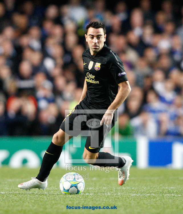 Picture by Andrew Tobin/Focus Images Ltd. 07710 761829. 18/04/12 Xavi of Barcelona on the ball during the first leg of the Champions League semi final match between Chelsea and Barcelona at Stamford Bridge, London, UK