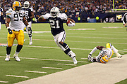 IRVING, TX - NOVEMBER 29: Running back Julius Jones #21 of the Dallas Cowboys high steps along the sideline during a run while chased by defensive tackle Corey Williams #99 and safety Nick Collins #36 of the Green Bay Packers on November 29, 2007 at Texas Stadium in Irving, Texas. The Cowboys defeated the Packers 37-27. ©Paul Anthony Spinelli *** Local Caption *** Julius Jones;Corey Williams;Nick Collins