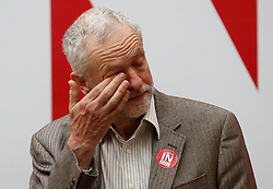 © Licensed to London News Pictures. 10/05/2016. London, UK. Labour Party leader JEREMY CORBYN wipes his eye during the official unveiling of the new Labour In For Britain campaign bus. Alan Johnson, Chairman of 'Labour In for Britain', Labour deputy Tom Watson and Gloria De Piero, Shadow Minister for Young People and Voter Registration, also attended. Photo credit: Peter Macdiarmid/LNP